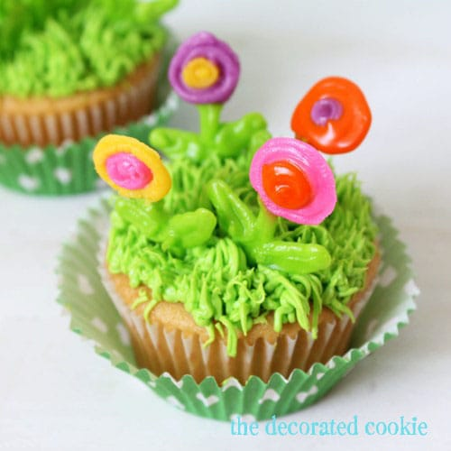 spring cupcakes: royal icing flowers on field-of-grass cupcakes