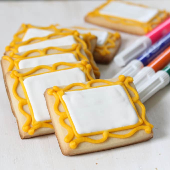 Decorate art canvas cookies and package with food coloring pens for art party favors.Kids design their own cookies.