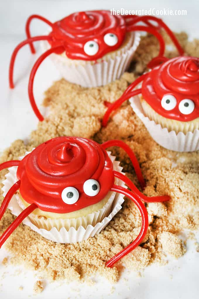 red crab cupcakes on brown sugar sand