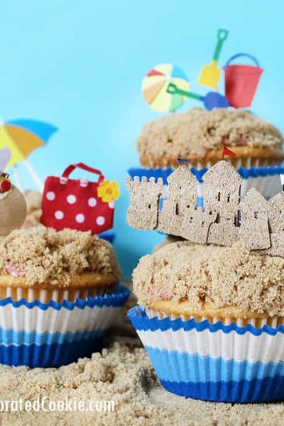 beach themed cupcakes on brown sugar sand
