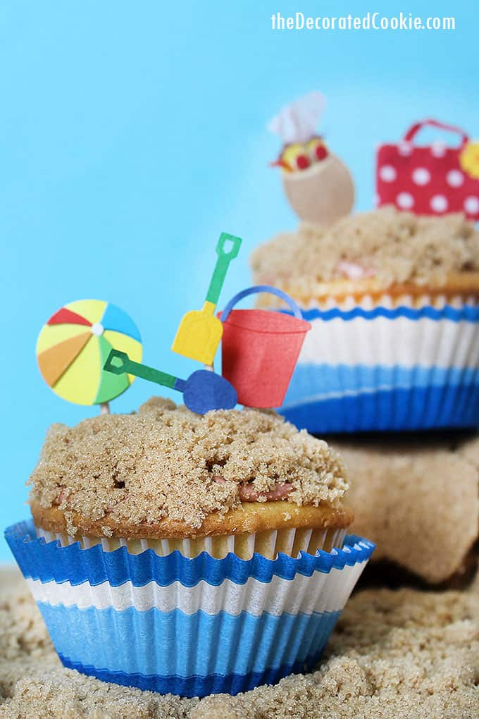 beach themed cupcakes on brown sugar sand