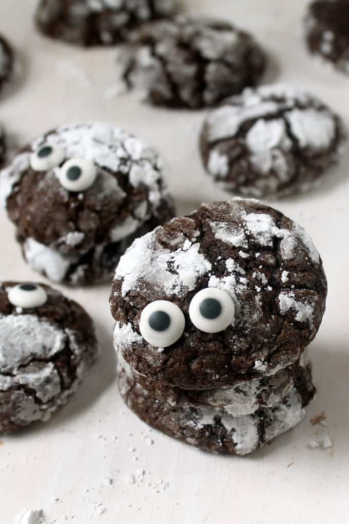 COCOA CRACKLE COOKIES recipe: Add candy eyes to delicious cocoa crackle cookies to make cookie monsters for halloween. A fun food idea.