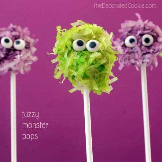 Fuzzy chocolate monsters pops combine coconut and chocolate on a stick, a cute and easy monster treat for your Halloween party food.