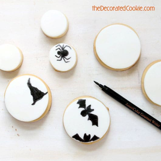 Make easy decorated Halloween cookies with just fondant and one black food coloring pen. Fun food for Halloween. Sweet Halloween treat idea.