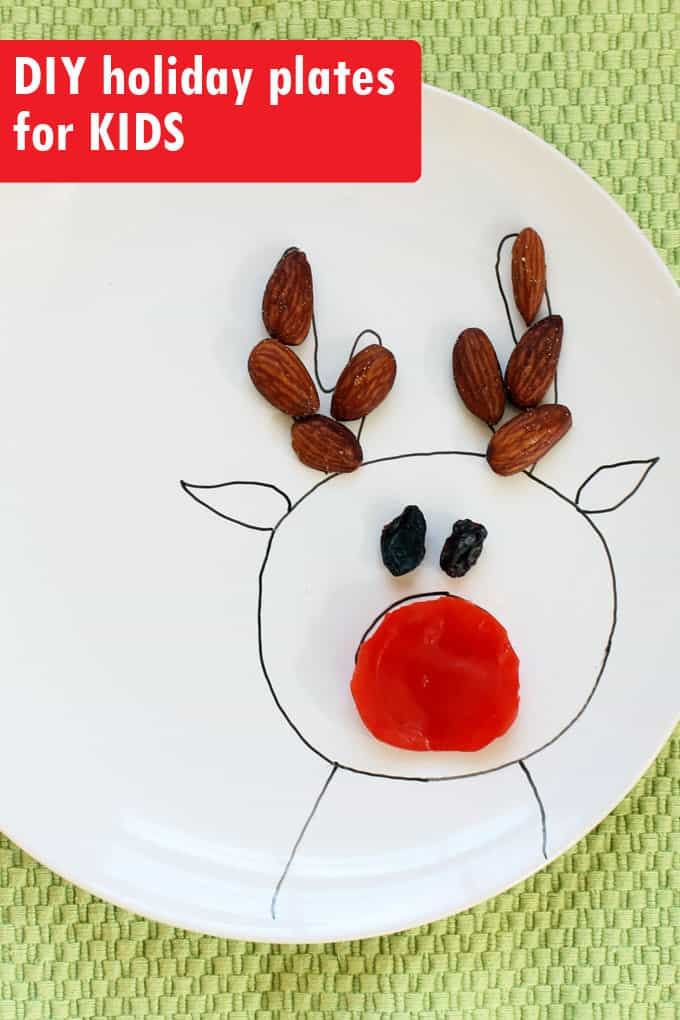 Draw Christmas and winter scenes on plates for kids to create food art. DIY Christmas plates from inexpensive plain white dishes and a China Paint Pen.