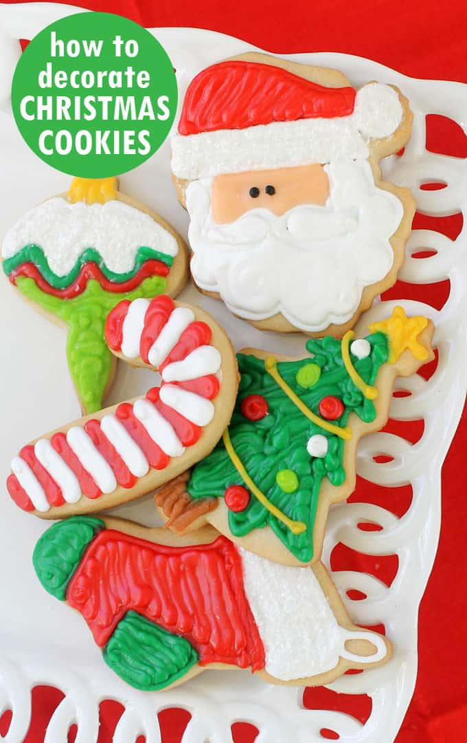 STEP-BY-STEP GUIDE TO DECORATING CHRISTMAS COOKIES -- Everything you need to know, cookie decorating basics, icing and cut-out cookie recipes, how to decorate the cookies seen here, tips on making ahead and freezing. #Christmascookies #cookiedecorating