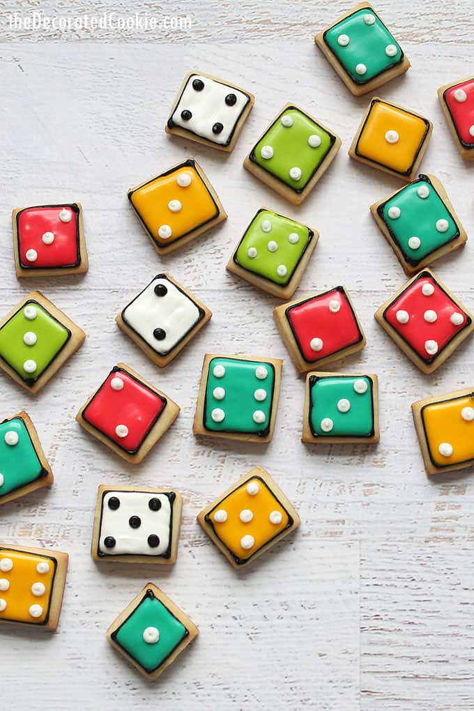 colorful bite-size DICE COOKIES, a fun food idea for game night. Recipes for cut-out sugar cookies, royal icing, and how to color icing.