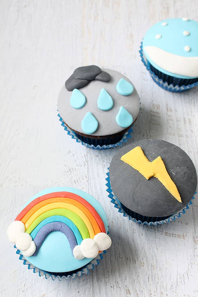 WEATHER CUPCAKES -- How to decorate cupcakes with fondant to make lightning, a rainbow, sow, and rain. Fun food idea for a weather-themed party.