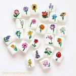 25 flowers drawn on marshmallows
