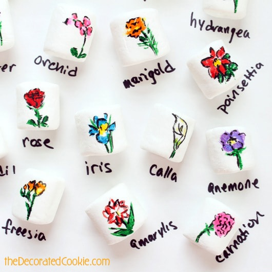 25 flowers drawn on marshmallows