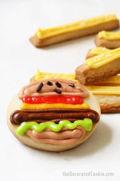 mini decorated cookies with royal icing, burger and fries