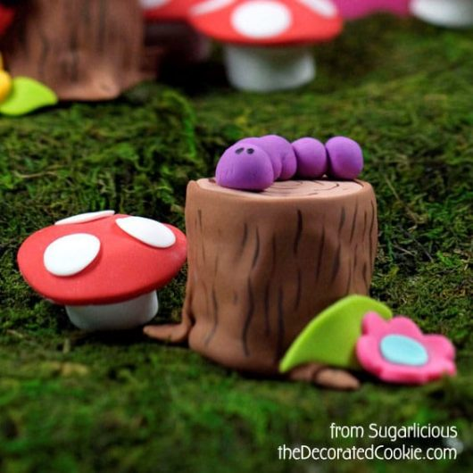 Create a fairy woodland with petits fours and marshmallows.