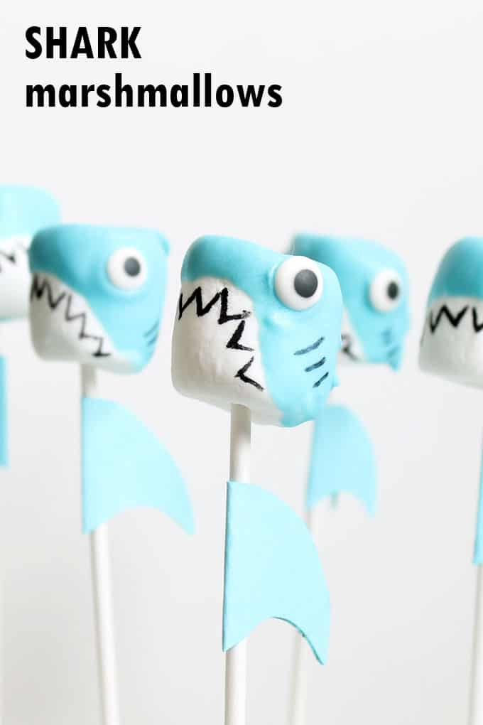 SHARK marshmallow pops for SHARK WEEK! Fun food idea using marshmallows, candy melts, and food coloring pens. Summer party food. #SharkWeek #SharkMarshmallows