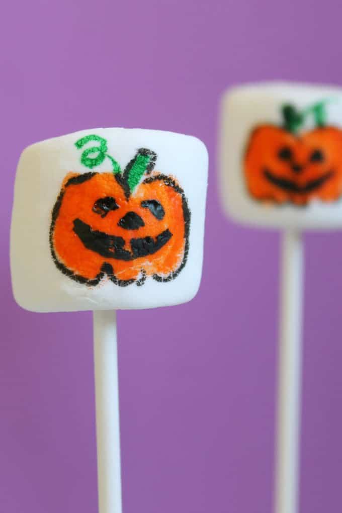 how to draw Halloween Jack O' Lantern marshmallows -- food coloring pens and marshmallows for an easy Halloween treat idea