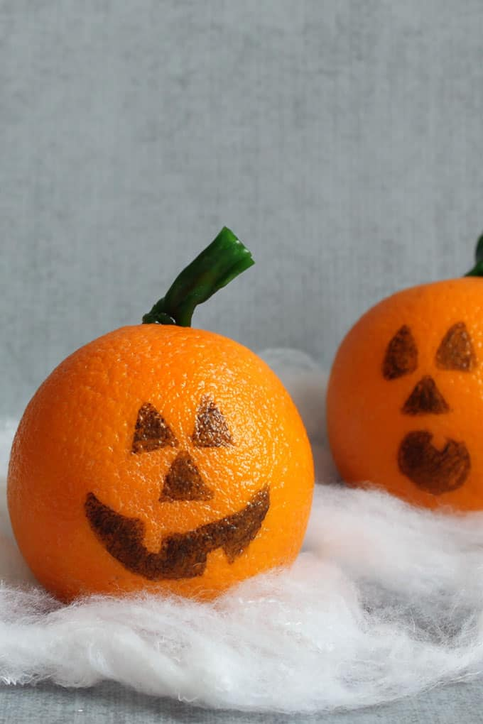 Healthy Halloween treats and snacks: jack o' lantern oranges