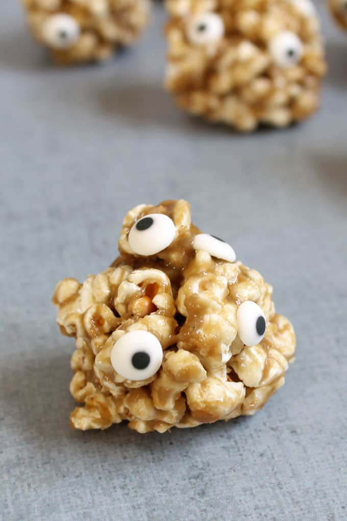 Healthy Halloween treats and snacks: healthy popcorn ball monsters