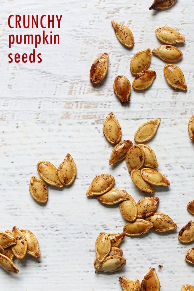PUMPKIN SEEDS: Maple cinnamon roasted pumpkin seeds with CRUNCH! A delicious, sweet and salty, healthy snack for fall.
