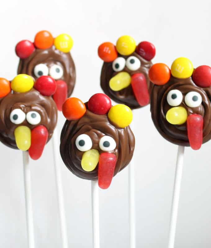 These easy chocolate turkey pops are a fun food idea for Thanksgiving. Great for the kids' Thanksgiving table or for party favors.