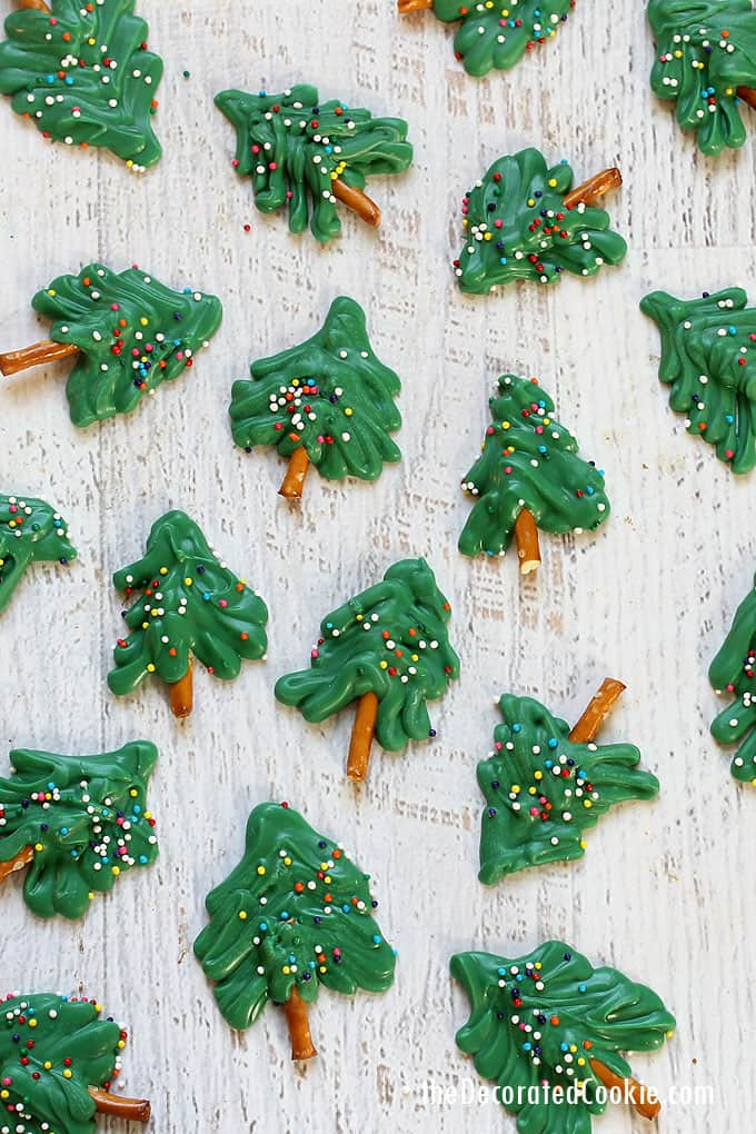 These cute mini 3-ingredient CHOCOLATE CHRISTMAS TREES with pretzels are easy, fun treat to make and give for the holidays. Step-by-step instructions are included.