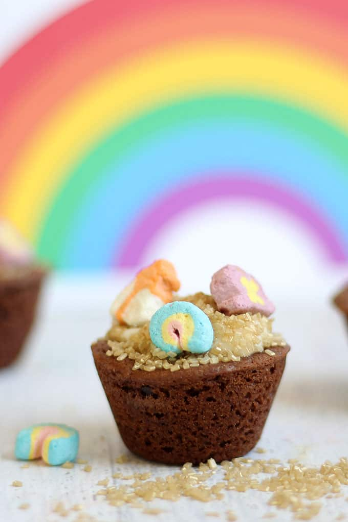 ST. PATRICK'S DAY COOKIE CUPS: Lucky Charms top sparkly pot of gold chocolate cookie cups for a fun St. Patrick's Day dessert.