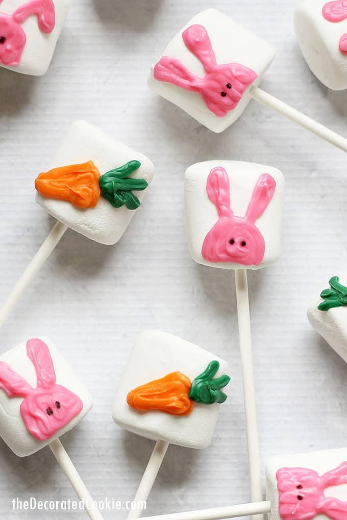 Simple Easter marshmallow idea: Bunny and carrot Easter marshmallow pops made with candy melts.