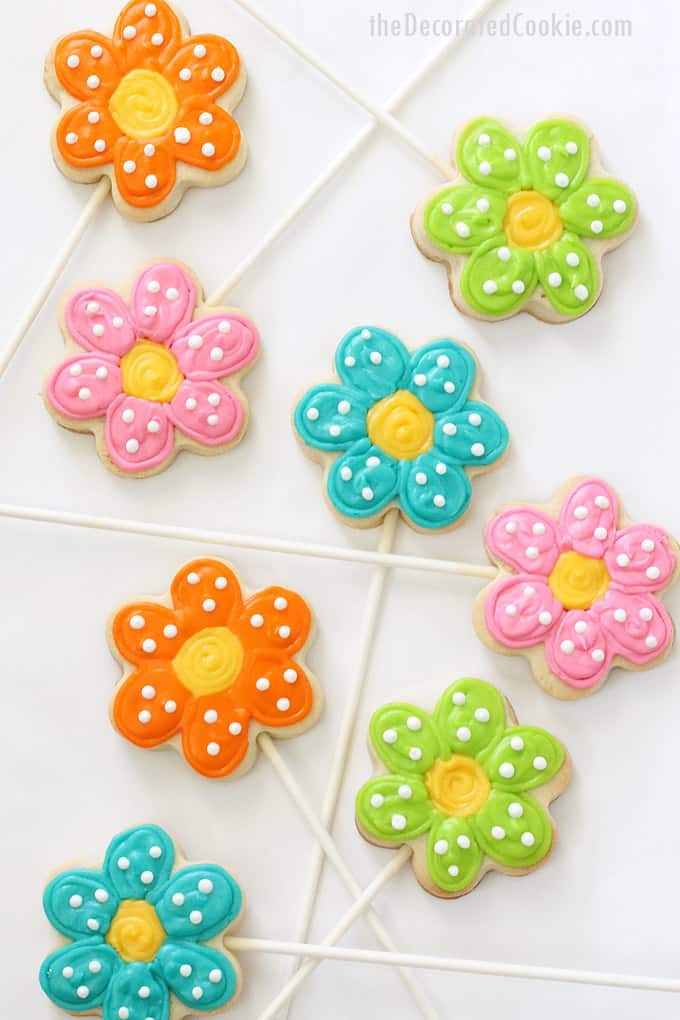 How to make simple POLKA DOT FLOWER COOKIE POPS in an arrangement for Mother's Day or spring. Cut-out sugar cookies on sticks with royal icing.