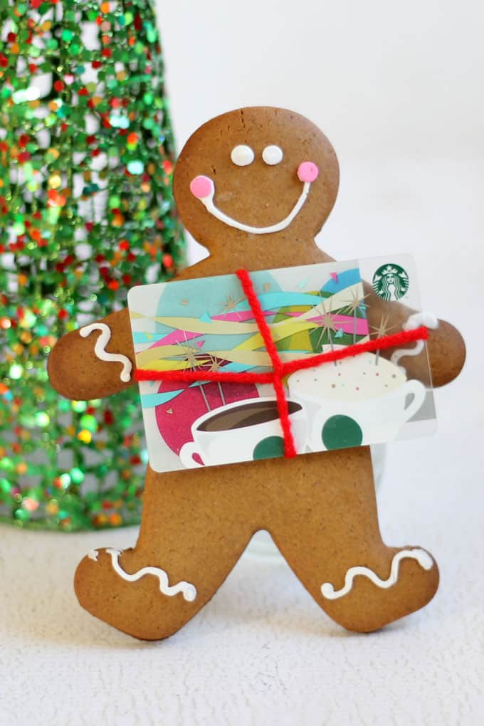 GINGERBREAD COOKIE GIFT CARD HOLDER adds a bit of homemade love to standard, ho-hum Christmas gift cards. Includes best no-spread gingerbread cookie recipe. #gingerbread #gingerbreadman #christmasgifts #giftidea #giftcardholder #gingerbreadcookies #recipe #christmascookies