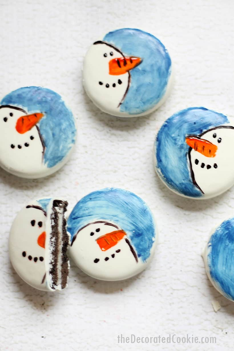 white fudge covered Oreos painted with snowmen for Christmas cookies