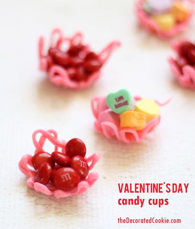 Valentine's Day candy cups by the decorated cookie