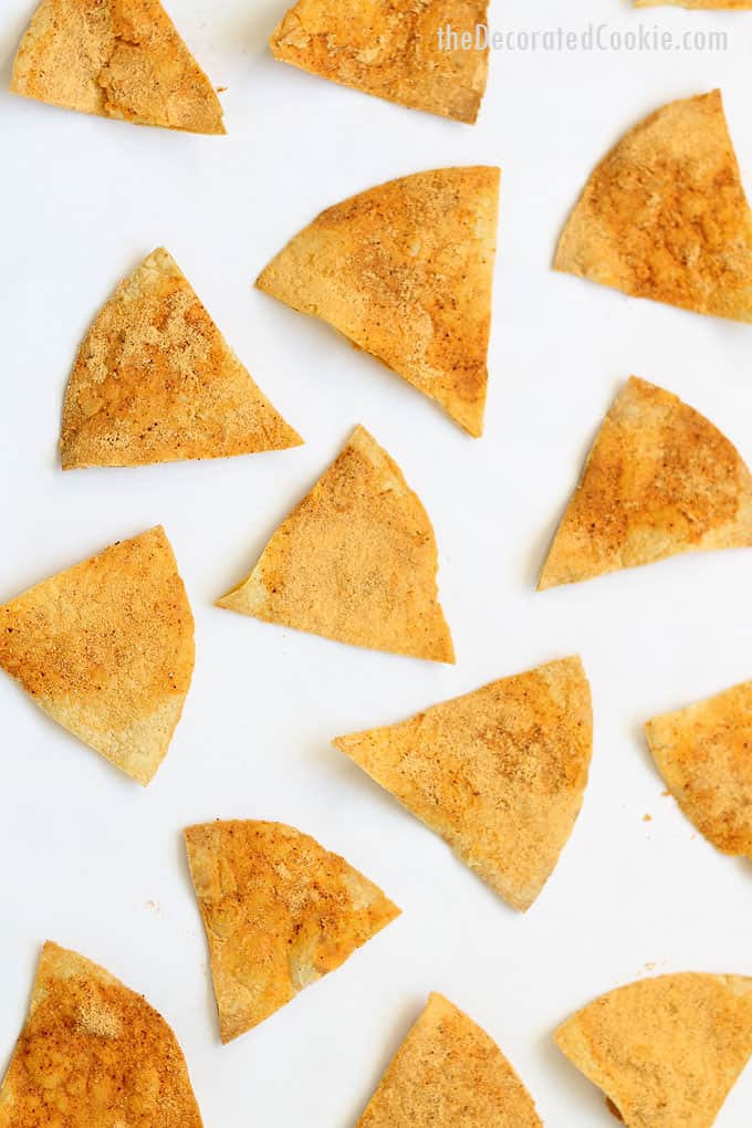 HOMEMADE DORITOS -- copycat recipe. How to make your own Doritos at home, an addictive, cheese-covered snack made with tortillas and cheddar.