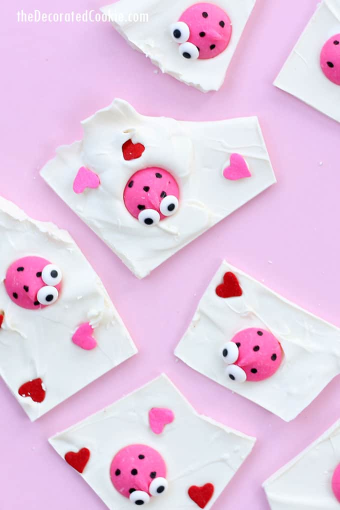 LOVE BUG CHOCOLATE BARK -- A cute and easy Valentine's Day treat with heart sprinkles and lady bug candy melts. Fun for kids.