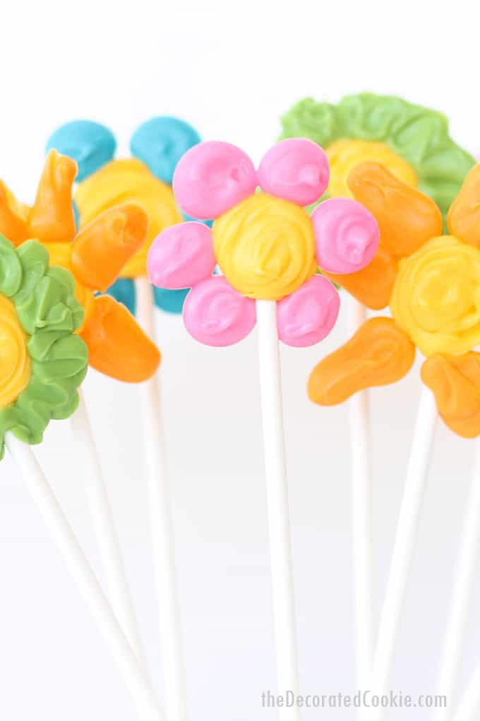 Easiest ever candy flower pops, a cute spring treat kids can make for Mother's Day with colorful candy melts. Video tutorial included.
