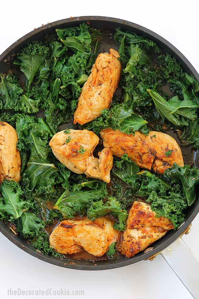 CHICKEN AND KALE IN WHITE WINE with herbs. Serve over rice for an easy, quick, weeknight dinner idea. Delicious chicken recipe idea.