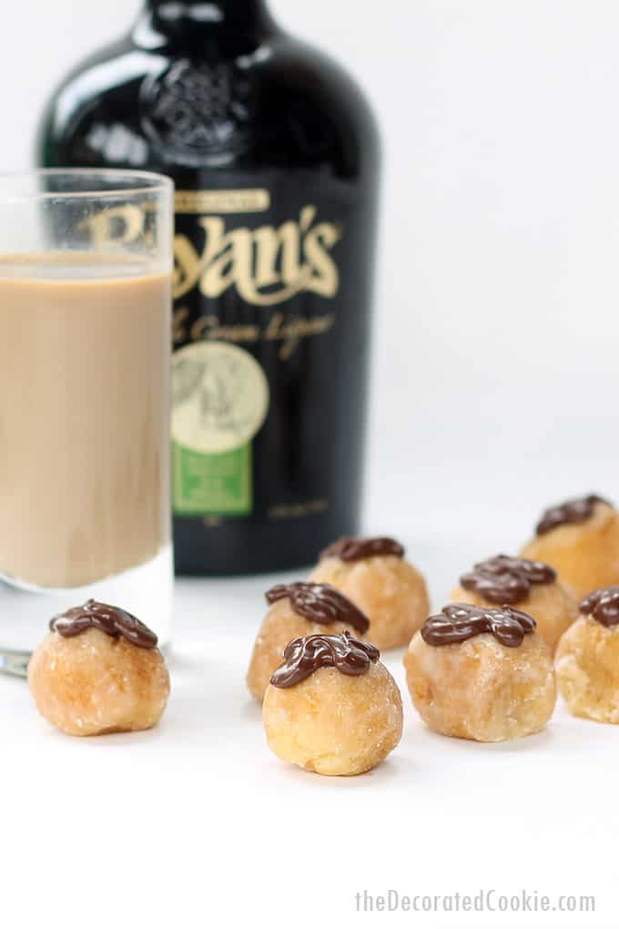 BOOZY DONUT HOLES are easy to make and a hit to serve at brunch. Filled with Bailey's and topped with chocolate. Video how-tos included.