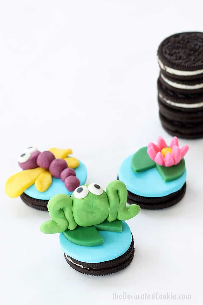 CANDY CLAY FROG OREOS -- with dragonfly and water lily. Fun food idea for spring, an animal party, or just for fun with kids.