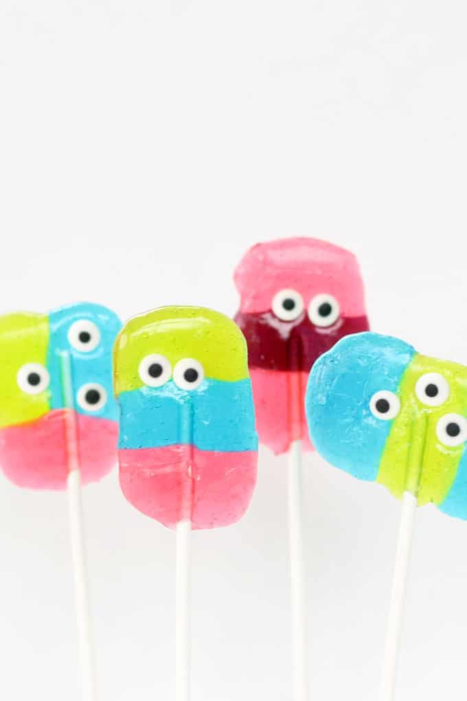 Simple monster Jolly Rancher lollipops are a kid-friendly fun Halloween party food or monster party treat. Easy to make using hard candy and candy eyes. #Halloween #jollyrancher #lollipops #monster