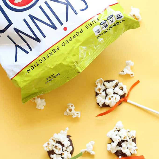 Combine popcorn and chocolate for a simple, fun food treat idea: Chocolate popcorn pops! Kid-friendly treats -- fun for Halloween or Thanksgiving.