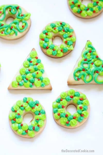 Christmas cookies decorated as trees and wreaths with royal icing