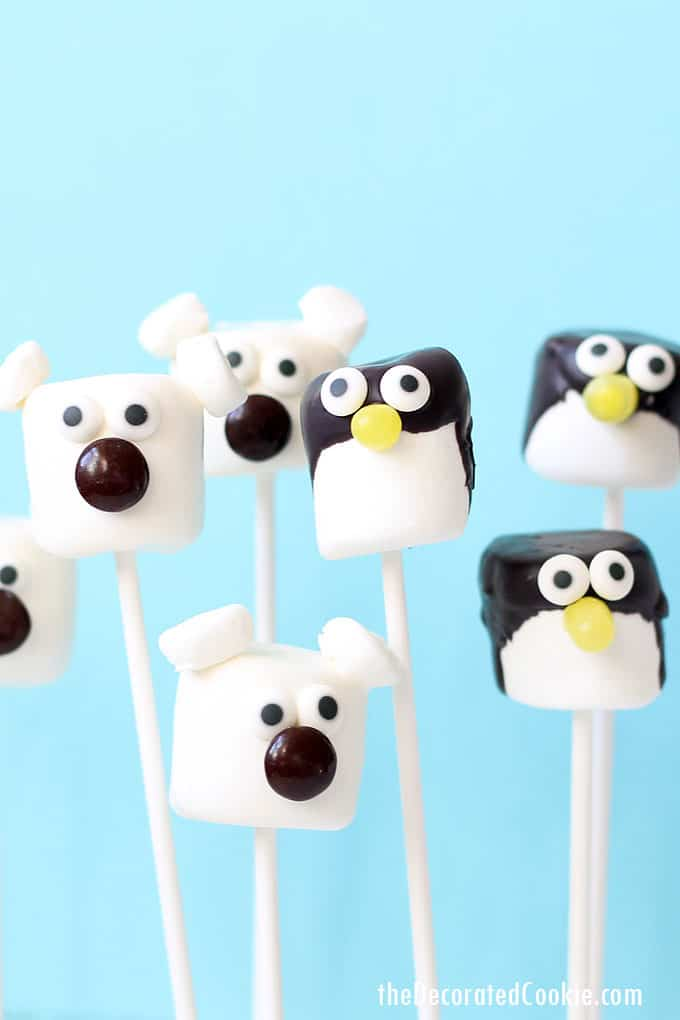 These cute polar bear and penguin marshmallow pops are a cinch to make! A fun and easy winter treat. Winter animals as fun food.