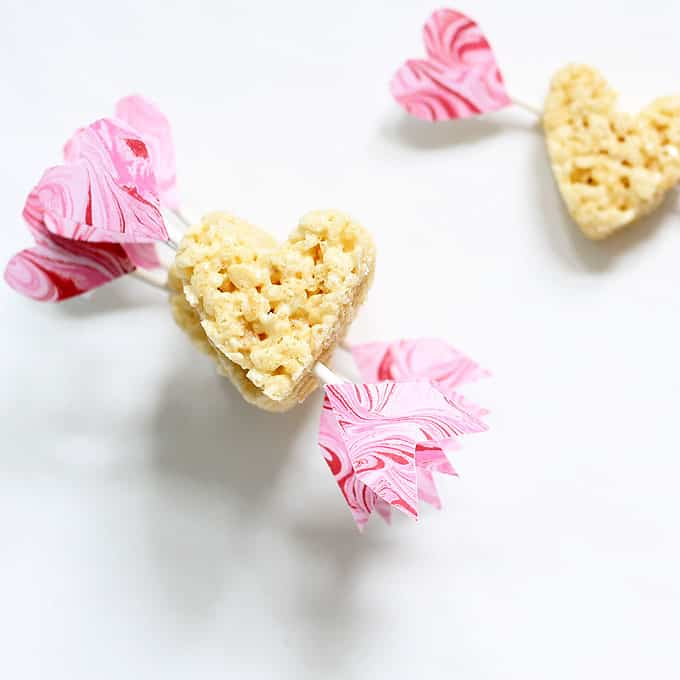 Easy treat to make: Cupid's arrow Rice Krispie Treats for Valentine's Day. Heart cereal treats. Video how-tos included. Classroom party idea.