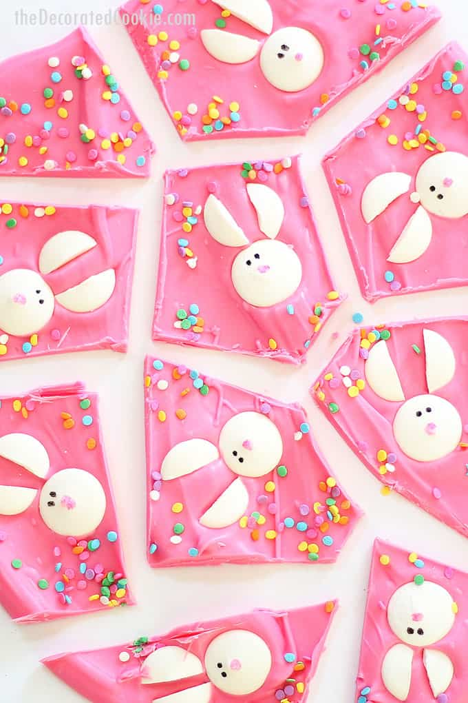 Chocolate Easter bunny bark is a fun food treat idea for Easter. Pink chocolate topped with candy melt bunnies. Video how-tos included.