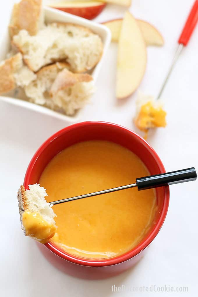 This easy BEER AND CHEESE FONDUE tastes delicious and takes no time at all to make. The perfect appetizer for any party.  Dip pretzels, bread, whatever.