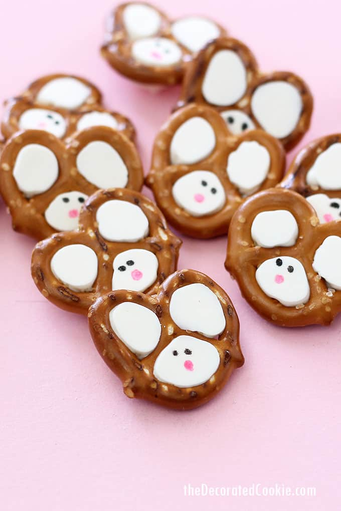 Easy Easter bunny pretzels made with pretzels, chocolate, and food writers. Video step-by-step instructions are included.