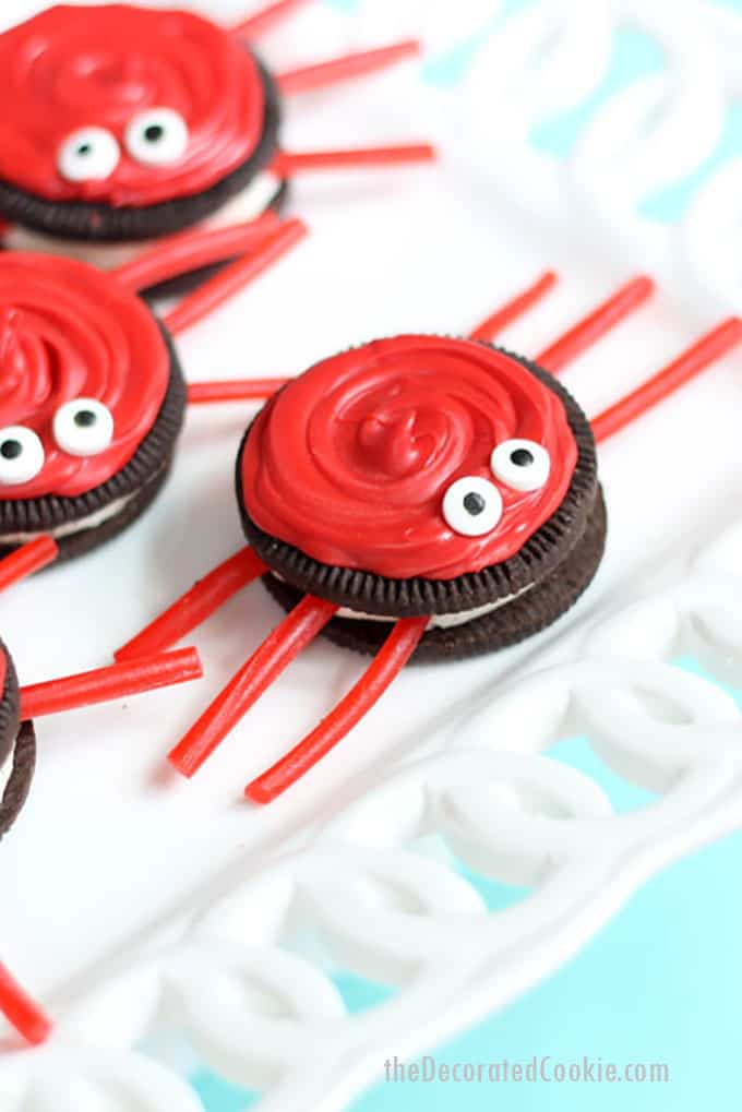 Oreo crabs with red candy melts and licorice legs