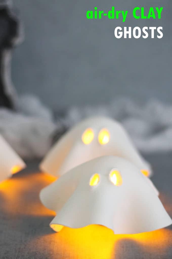 An easy air-dry clay ghost tea lights Halloween craft for a fun and easy Halloween decor idea. #halloween #crafts #Halloweencraft #airdryclay #ghosts #tealight