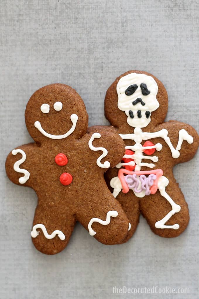 Halloween gingerbread man -- Traditional gingerbread man cookies hide skelton gingerbread cookies (with anatomy and all). Great Halloween cookies!!