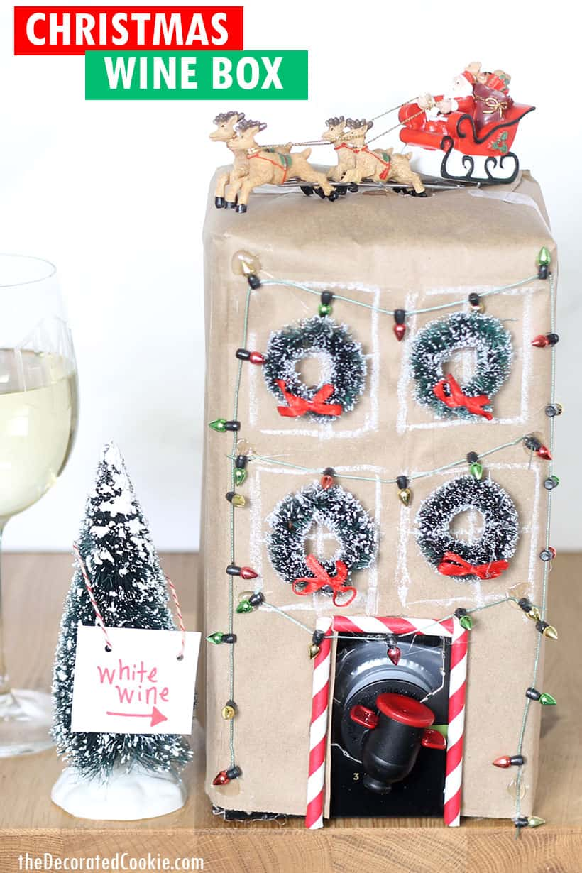 Box of wine decorated as Christmas townhouse for Christmas party