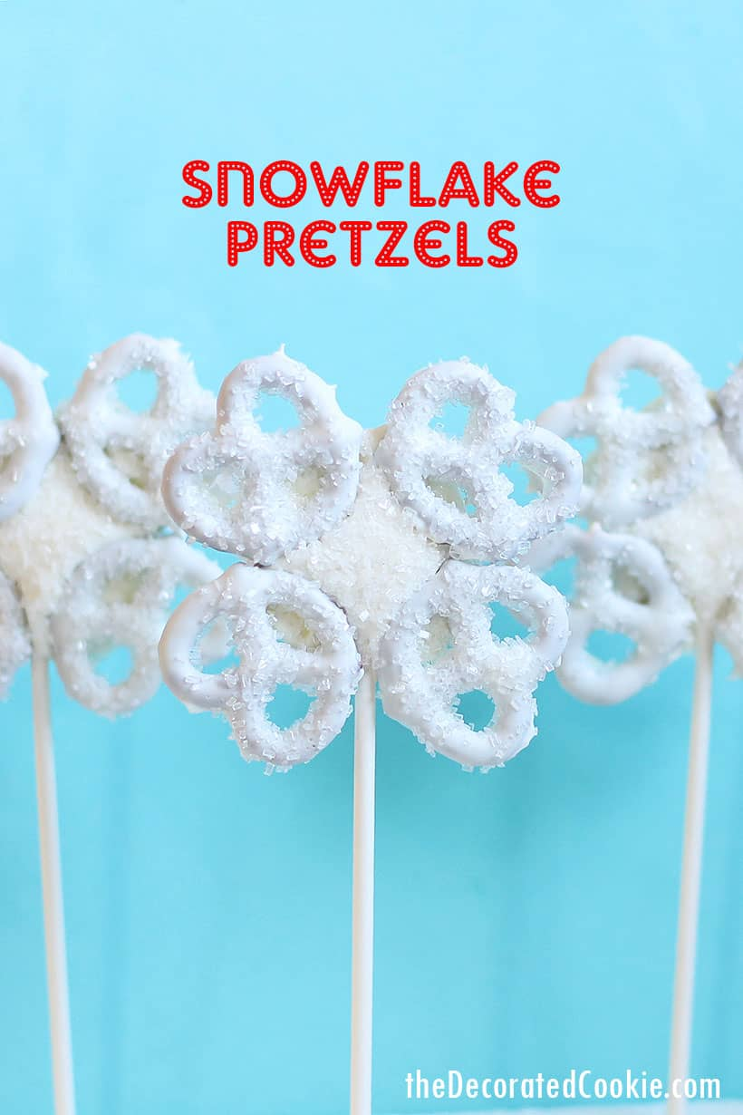 snowflake pretzels on a stick with blue background