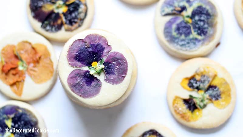 These gorgeous orange cookies with edible flowers are delicately flavored with orange extract and topped with a sprinkle of sugar. For afternoon tea, a lovely gift, or just to enjoy, these floral cookies are just right.These cookies use Nielsen-Massey's Pure Vanilla Extract and Pure Orange Extract. (Sponsored by Nielson-Massey) #NielsenMasseyPartner