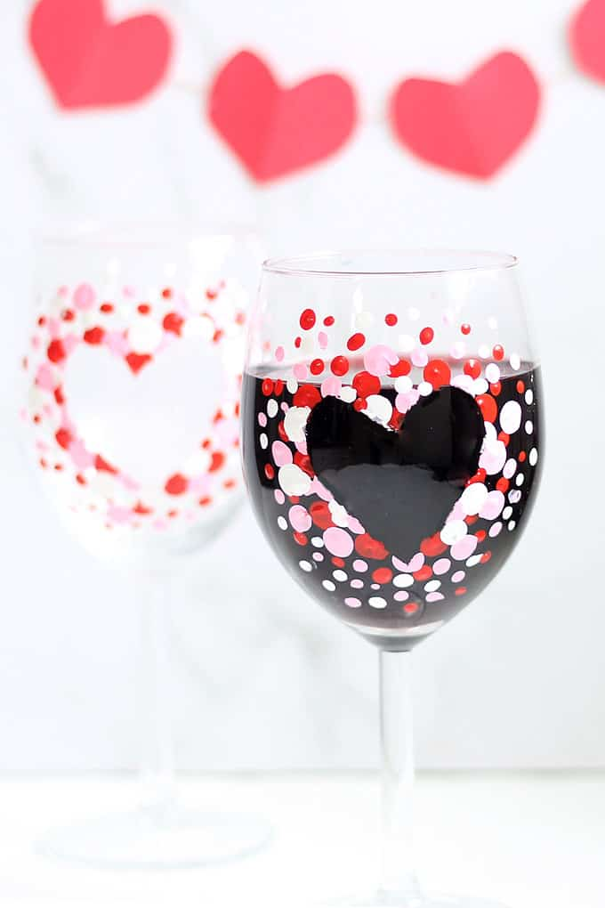 How to make hand painted Valentine's Day wine glasses. #valentinesday #wineglasses #glasspainting #valentinesdaycrafts